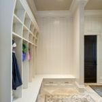 Angled mudroom upper cabinets with bench