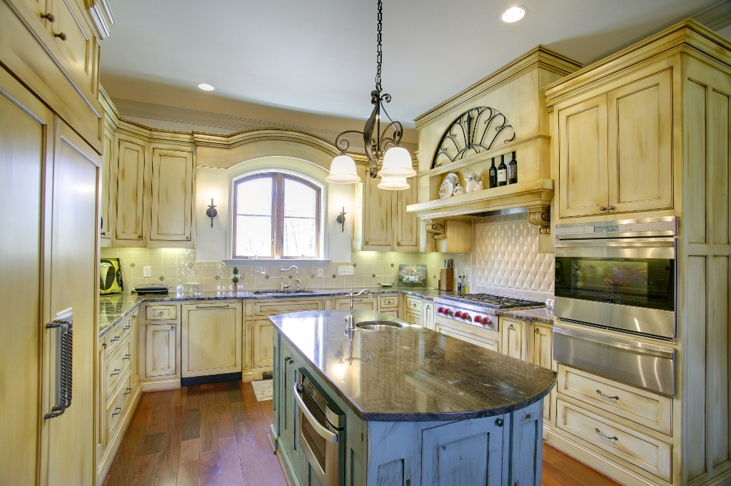 Antique white painted kitchen cabinets with a glaze for Antiquing painted kitchen cabinets