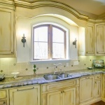 Arched window and crown with sconces