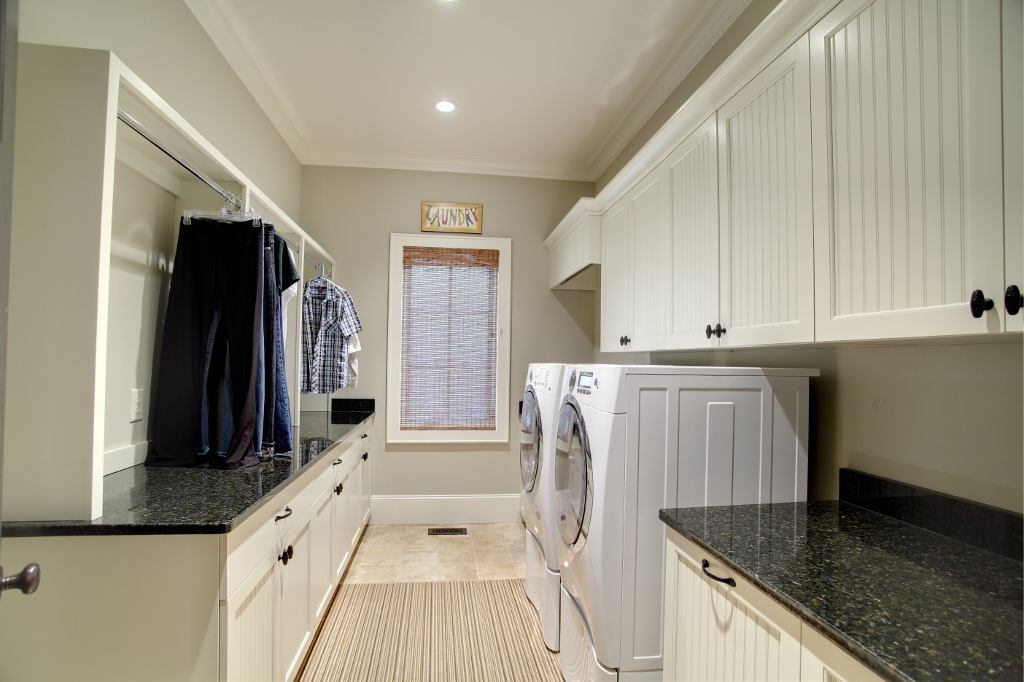 Bead panel cabinetry laundry room