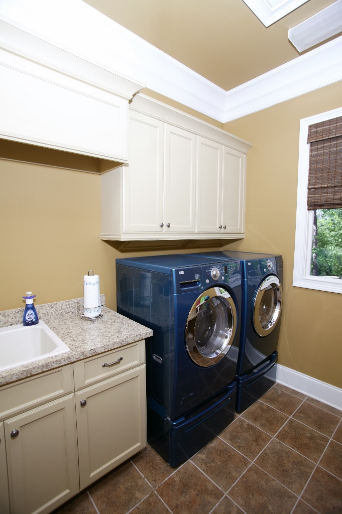 Blue washer and dryer with white shaker cabinets