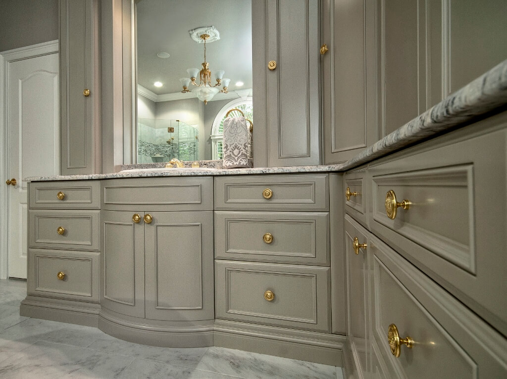 Bow front vanity with brass decorative hardwaare