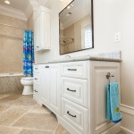 Boys bath white cabinetry