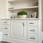 Inset cabinetry in divine white bookcase