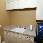 Laundry room with custom painted cabinets