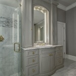 Lighted vanity towers and mirror
