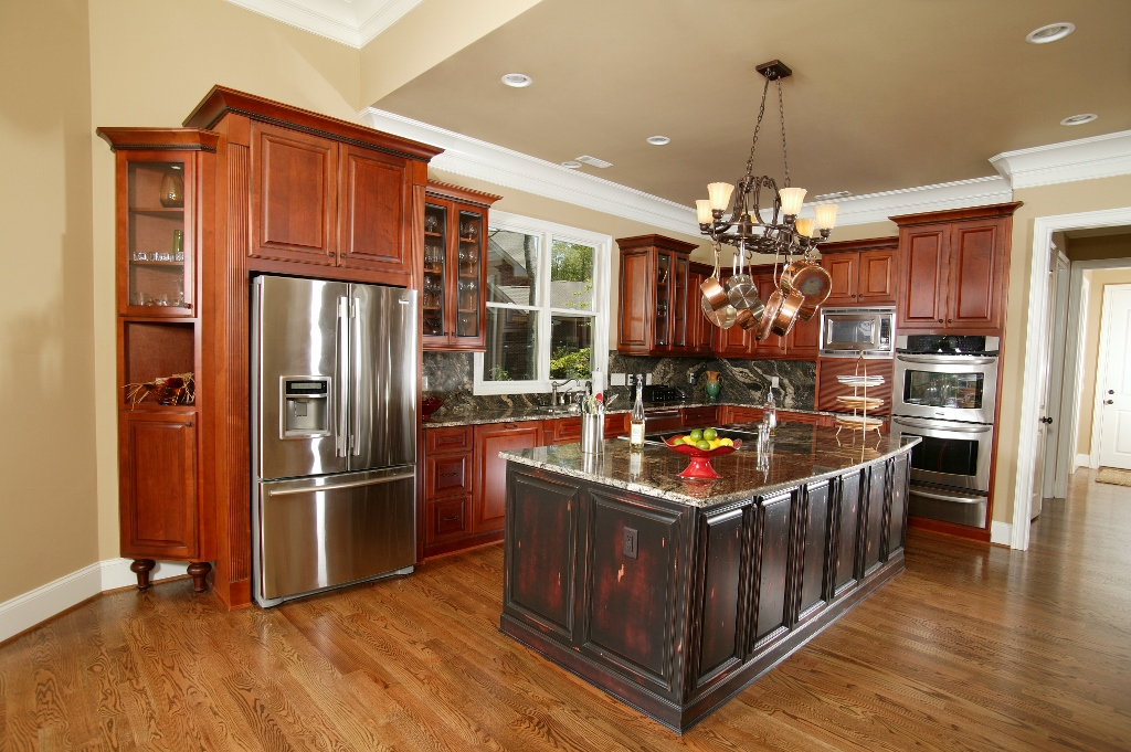 Stained alder cabinets with a painted island | Custom