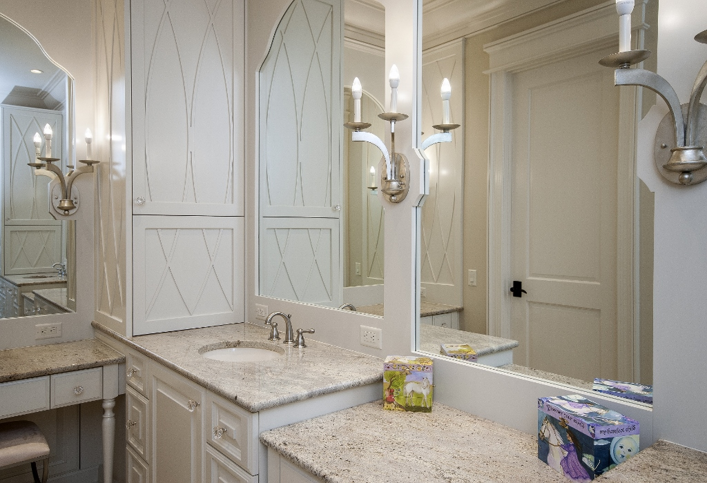 Tiered counter top vanities with sconces