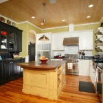 Transitional Kitchen with painted cabinets and wood top island