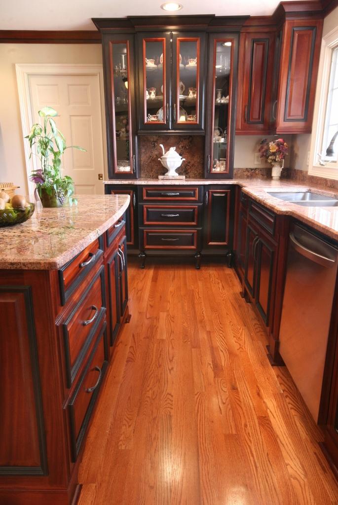 black furniture grade kitchen hutch with glass panels