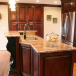black island leg with stained cabinets