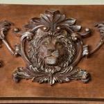 close up lion carving desk