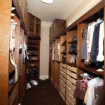custom closet with shoe storage and roll outs