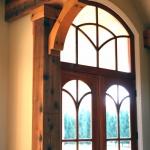 front door with ceiling beam