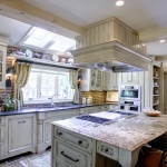 natural light kitchen white finish cooktop in island
