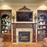 Custom built in with carved crown molding and corbels