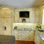 Custom paneled appliances with TV nook