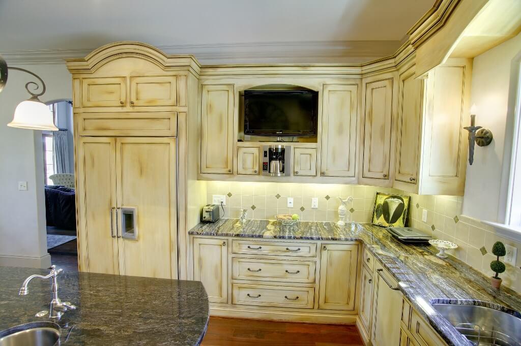 Custom paneled appliances with TV nook