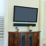 Living room TV hutch metal panel