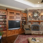 Living room entertainment center with mantle