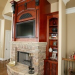 Stone fireplace with black applique