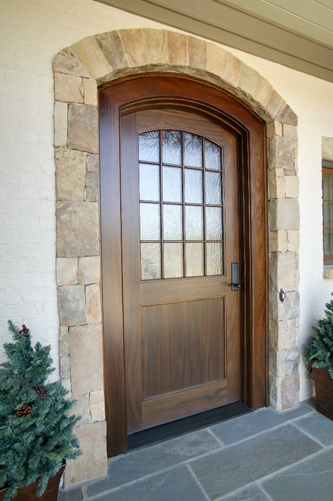 custom front door with arch with window stained